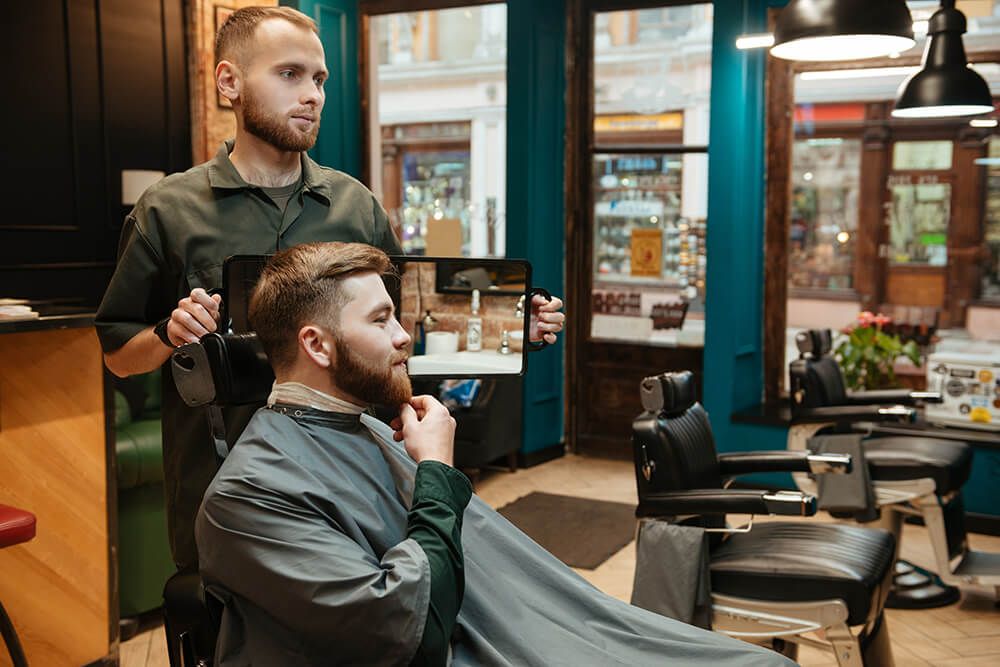 Man getting a haircut in a barber shop or hair salon