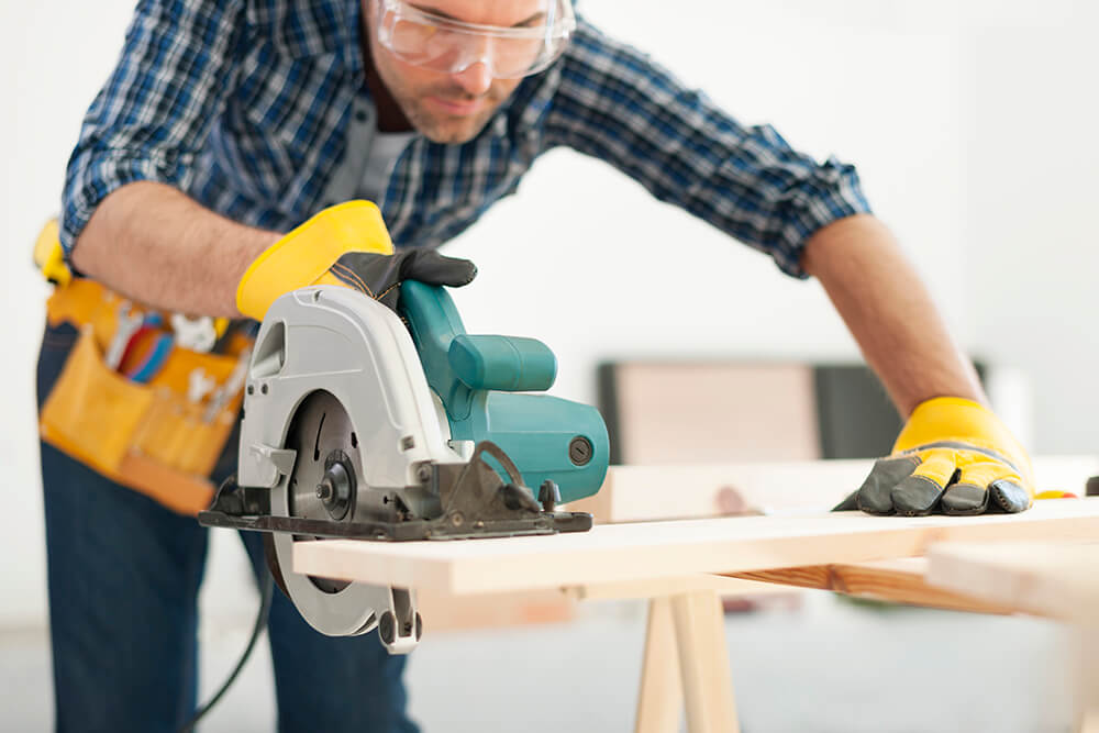 Carpenter using a circular saw on wood