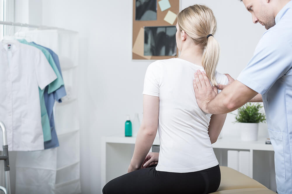 Woman getting a chiropractic adjustment by chiropractor