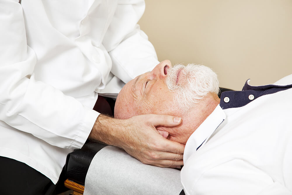 Man getting a chiropractic adjustment on head and neck