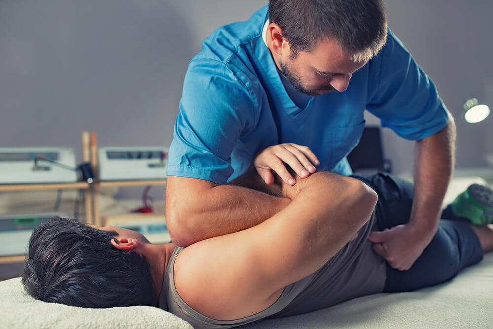 Man getting a chiropractic adjustment by a chiropractor
