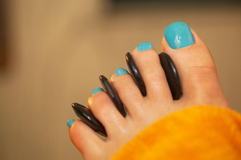 Woman getting a pedicure at the nail salon