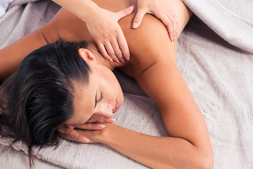 Woman getting a back massage at a spa