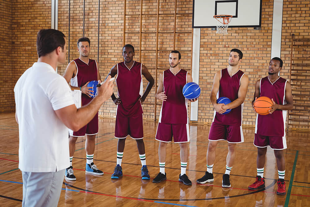 Guys on a basketball team with coach