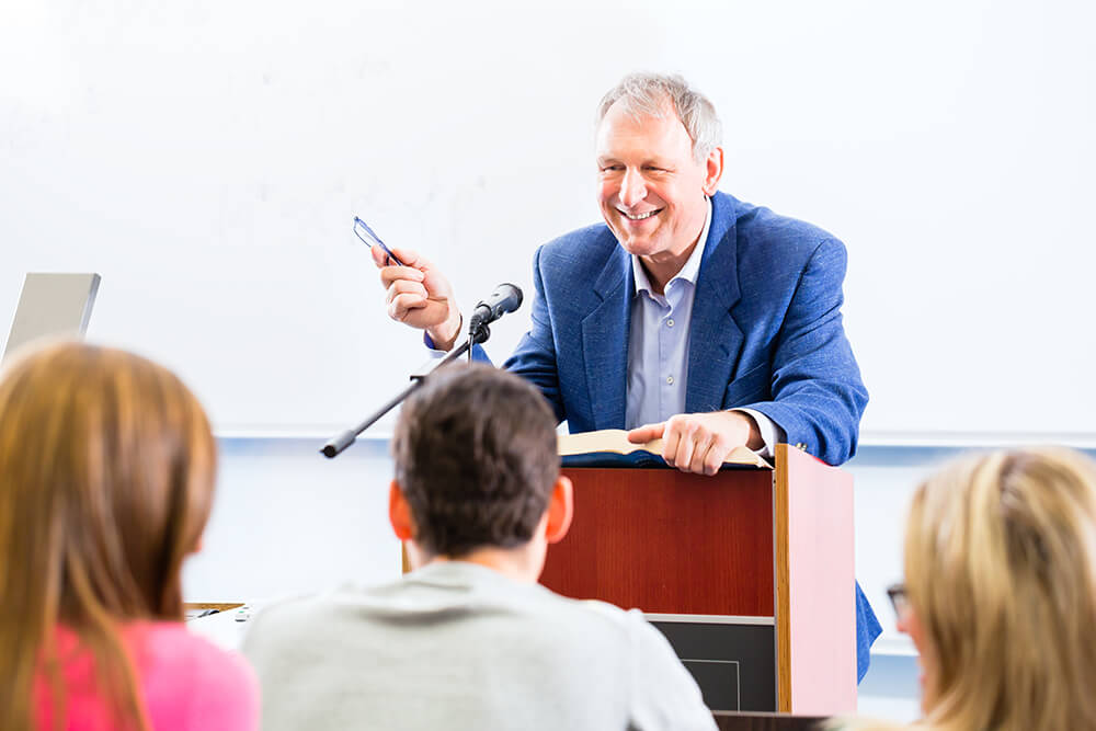 Professor teaching adult students in college