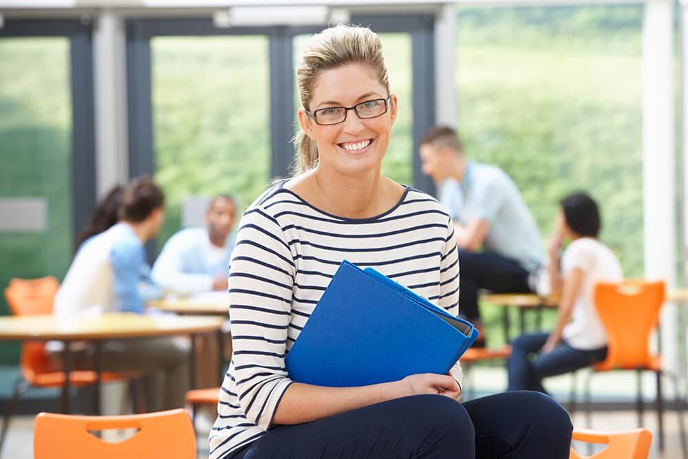 Tutor with folder in tutoring class